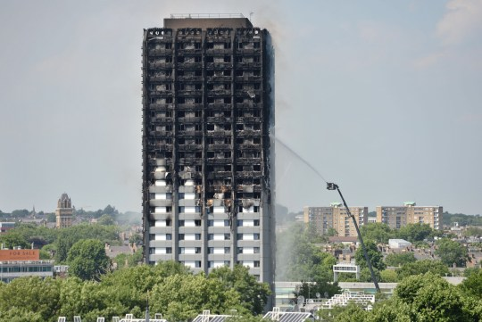 """File photo dated 14/06/17 of firefighters spraying water after the fire engulfed Grenfell Tower in west London. Families of those killed in the Grenfell Tower blaze fear a report into what happened will be """"buried in Brexit"""" after it was revealed that it will be published a day before Britain is due to leave the European Union. PA Photo. Issue date: Friday October 4, 2019. Prime Minister Boris Johnson, in a letter to inquiry chairman Sir Martin Moore-Bick, set a deadline of October 30 for making public the initial findings on the west London fire. See PA story POLITICS Grenfell. Photo credit should read: Victoria Jones/PA Wire"""