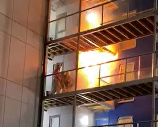 Handout videograb of fire fighters tackling the fire after it had just started on the top floors of a student accommodation building in Bolton, Greater Manchester. The fire eventually spread and engulfed the entire six-storey building. PA Photo picture date: Friday November 15, 2019. See PA story FIRE Bolton. Photo credit should read: Rafaela Nunes/PA Wire NOTE TO EDITORS: This handout photo may only be used in for editorial reporting purposes for the contemporaneous illustration of events, things or the people in the image or facts mentioned in the caption. Reuse of the picture may require further permission from the copyright holder.