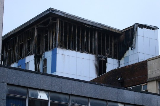 """The scene of a fire at student accomodation at the Cube in Bolton, Lancs. See SWNS copy SWLEfire: Firefighters have been tackling a huge blaze at a university student accommodation block. Crowds of students were evacuated from The Cube in Bolton, Lancs., when the fire broke out at about 8.30pm Friday. At its height about 200 firefighters from 40 fire engines were tackling the blaze which was affecting every floor. A witness said the fire was """"climbing up"""" the cladding of the six-storey building. One person was rescued by crews using an aerial platform."""