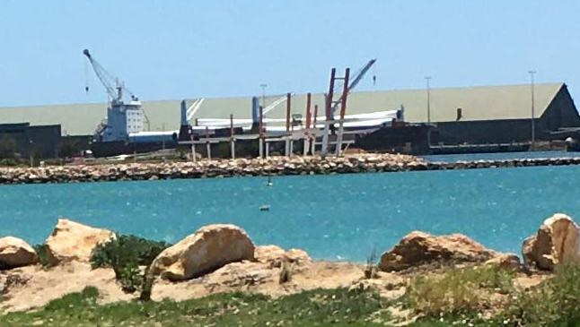 Wind turbines are unloaded from the ship at Geraldton Port today.