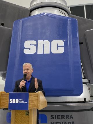 Steve Lindsey, a former astronaut and vice president of space exploration systems for Sierra Nevada, speaks at NASA's Kennedy Space Center on Nov. 19, 2019, at the unveiling of the Dream Chaser space plane's new cargo module.