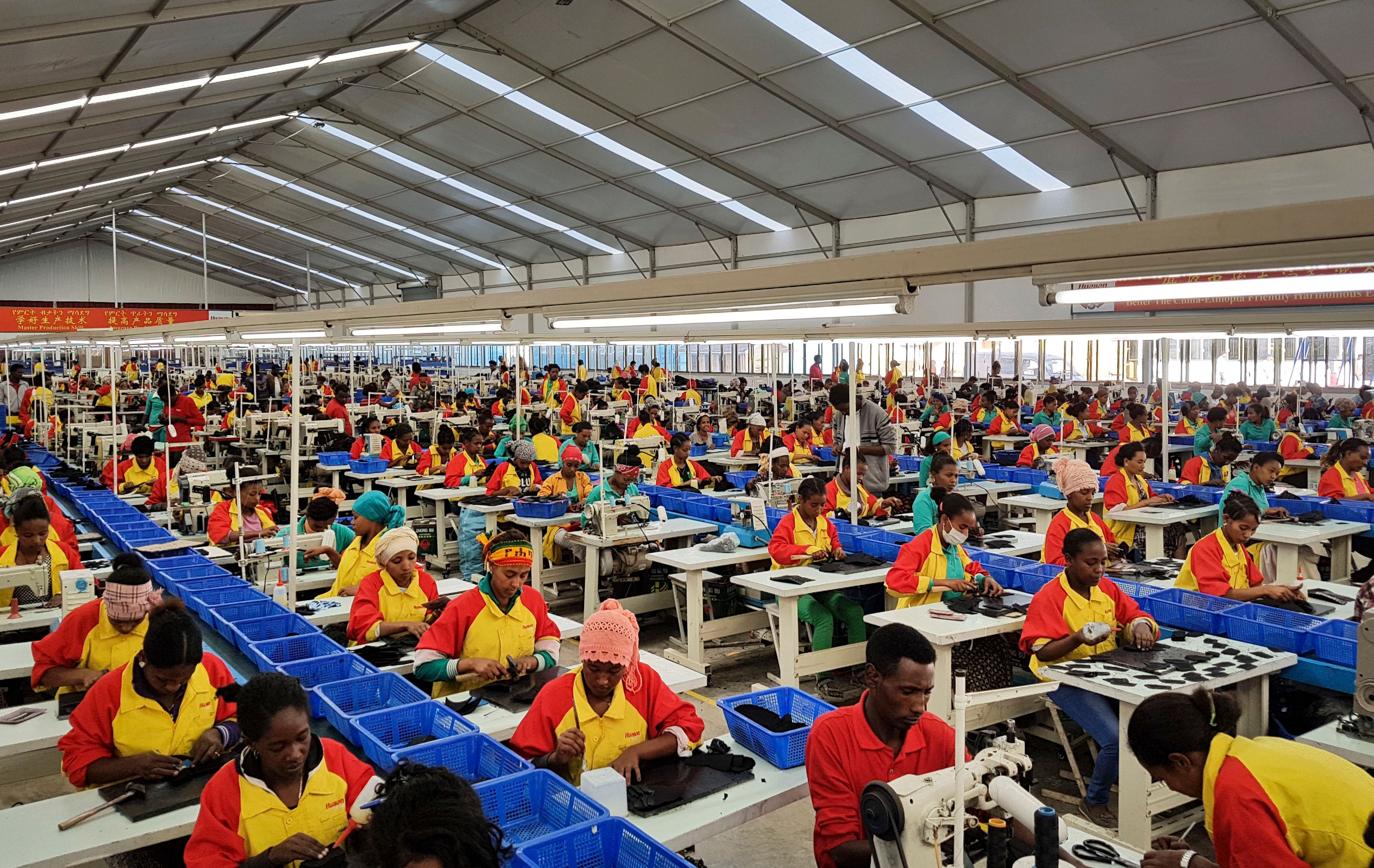 Ethiopian factory workers make shoes at the Chinese company Huajian's plant in Addis Ababa, Ethiopia. Workers from at Ganzhou Huajian International Shoe City Co., a southeastern China factory used by Ivanka Trump and other fashion brands, say they've faced long hours, low pay and verbal abuse. Huajian, meanwhile, has been moving production to Ethiopia, where workers make around $100 a month, a fraction of what they pay in China, according to Song Yiping, a manager at Huajian's Ethiopian factory, who spoke to the Associated Press in JanuaryChina Ivanka Trump Factory Life, Addis Ababa, Ethiopia - 05 Jan 2017