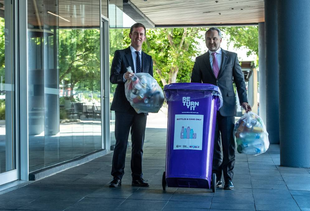 Minister for recycling and waste reduction Chris Steel and managing director of Re.Group David Singh launch an app where Canberrans can organise to have containers collected for the container deposit scheme. Picture: Karleen Minney