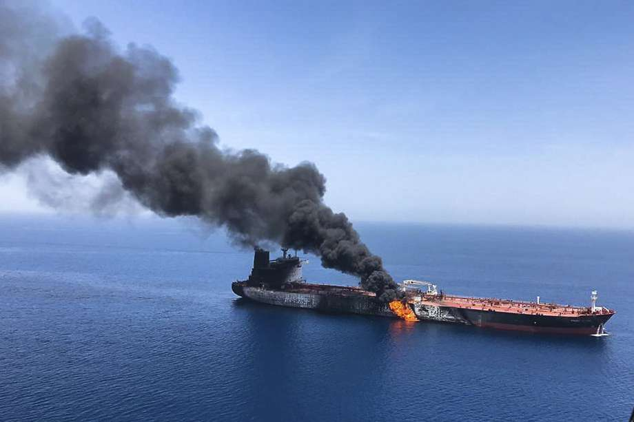 FILE - In this Thursday, June 13, 2019 file photo, an oil tanker is on fire in the sea of Oman. A series of attacks on oil tankers near the Persian Gulf has ratcheted up tensions between the U.S. and Iran -- and raised fears over the safety of one of Asia's most vital energy trade routes, where about a fifth of the world's oil passes through its narrowest at the Strait of Hormuz. The attacks have jolted the shipping industry, with many of operators in the region on high alert. (AP Photo/ISNA, File) Photo: Associated Press