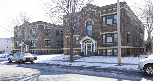Union Park Management in St. Paul has paid $3.53 million for this classic 28-unit brownstone apartment building, completed in 1926 at 119-123 W. 33rd St. in Minneapolis and a seven-unit building completed in 1959 at 3309 Pillsbury Ave. (Submitted photo: CoStar)