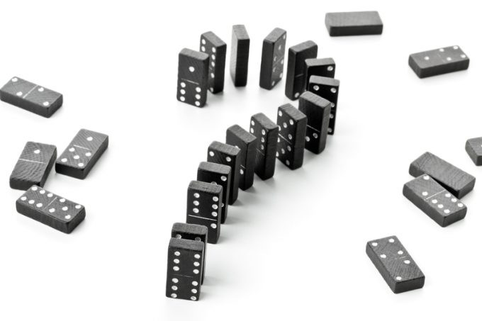 Risk, challenge or uncertainty concept - domino game stones form