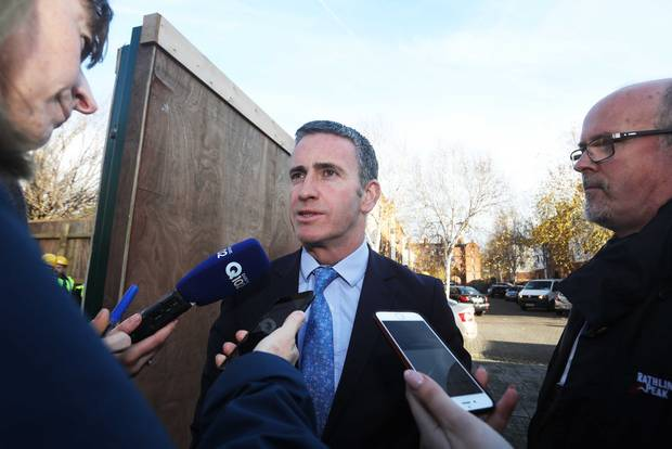Minister of State Damien English TD speaking to reporters at the sod turning of new social housing in Dublin 8. Photo: Leah Farrell/RollingNews.ie