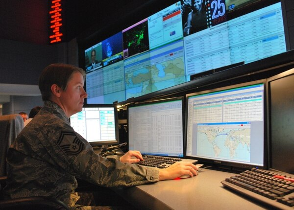 Senior Master Sgt. Donna Crone, pictured here at the 618th Air and Space Operations Center's 24-hour operations floor, works on the execution floor in 2010. (Capt. Justin Brockhoff/U.S. Air Force)