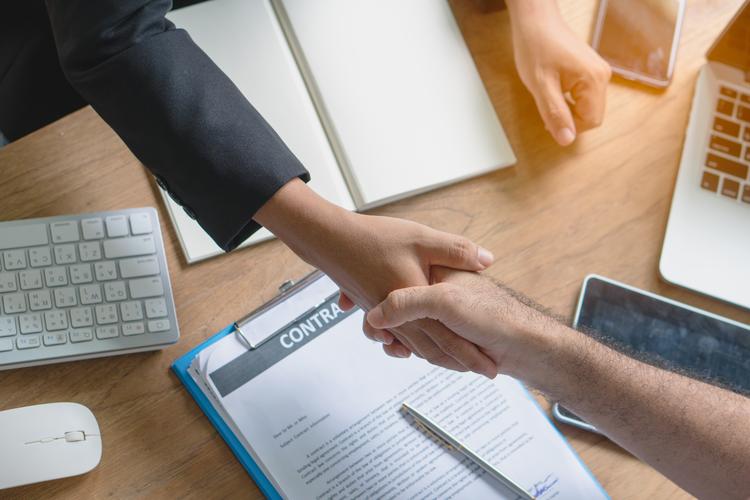 Business partners shake hands.