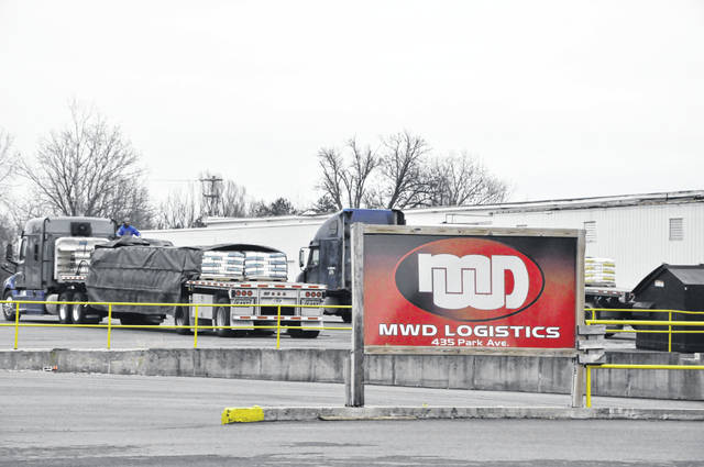 Owned by Milwaukee-based Phoenix Investors, the large warehouse at 435 Park Ave. in Delaware caught fire Monday morning. On Tuesday, crews were removing product from the damage facility.