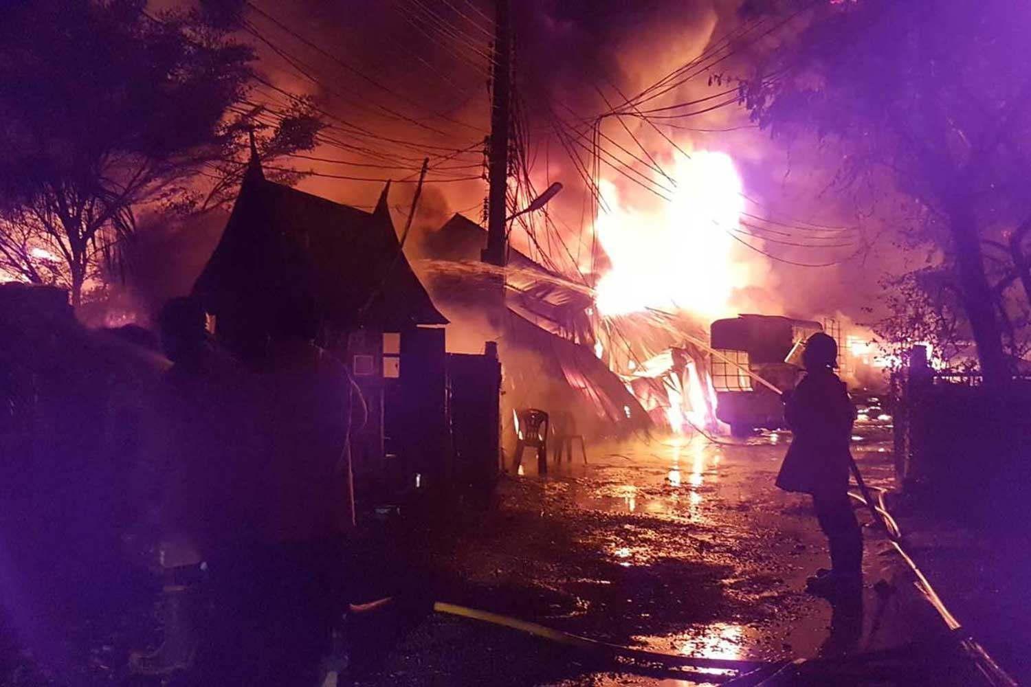 Firemen spray water onto a burning plastics factory in Samut Prakan's Muang district in the early hours of Saturday. (Photo by Sutthiwit Chayutworakan)