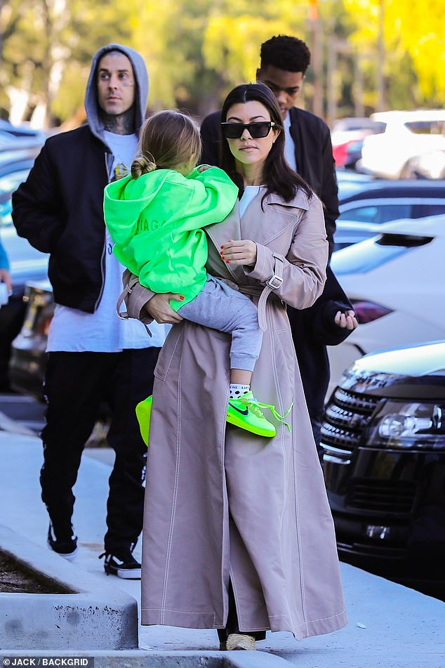 Kourtney's krew:Kourtney Kardashian was joined by two of her three kids, 10 year old Mason and five year old Reign, plus drummer Travis Barker as they visited Kanye West's warehouse.
