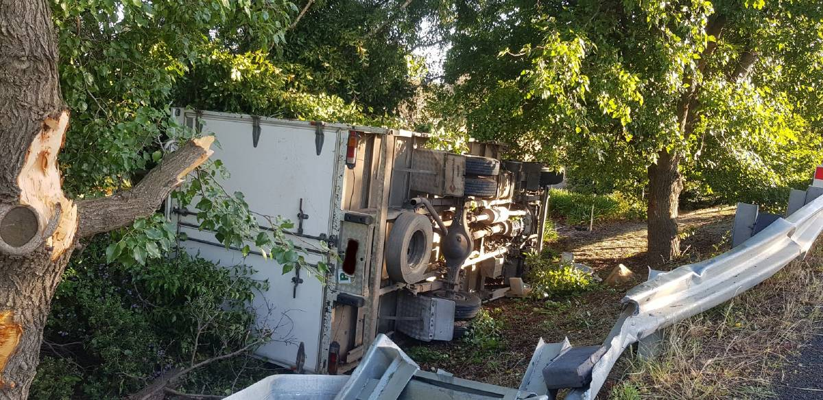 CRASH SCENE: A pantec truck crashed off Cargo Road and rolled on Tuesday morning. Photo: RFS
