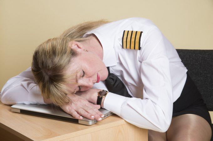 Tired female airline pilot