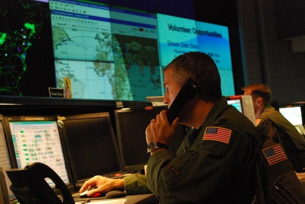 Lt. Col. Nicholus Costanzo, a Theater Direct Delivery Planner on the 618th Tanker Airlift Control Center's operations floor, coordinates a C-17 Globemaster III mission scheduled to deliver supplies to troops in Afghanistan in 2009.The 618th TACC is 18th Air Force's 24-hour Air and Space Operations Center, located at Scott Air Force Base, Ill. (Capt. Justin Brockhoff/U.S. Air Force)