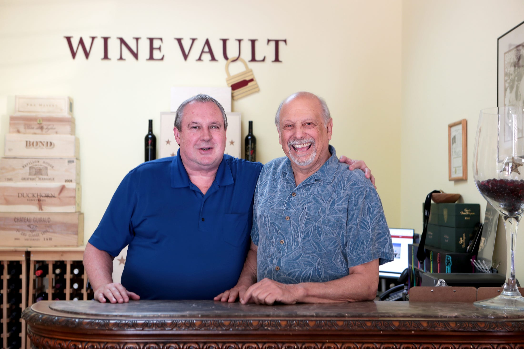 Wine Vault of the Desert general manager Jack Dixon, left, and director Ralph Iannuzzi are photographed inside their business in Palm Desert, Calif., on Wednesday, October 16, 2019. Their business has existed for about 10 years.