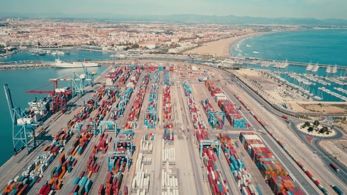 VALENCIA, SPAIN - OCTOBER 2, 2018. Aerial view of port container yard and cityscape