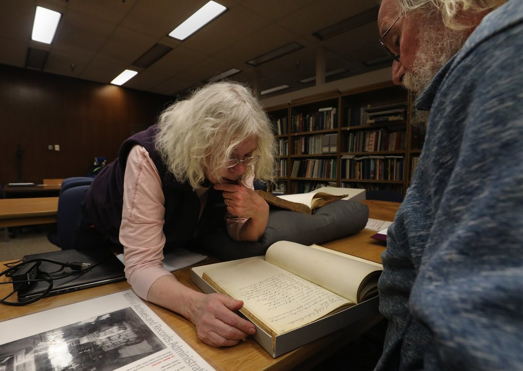 Susan Stoner and her husband George Slanina came up from Portland to do research at the National Archives on Sand Point Way. Stoner, a writer known by S.L. Stoner for her historical mystery books, is looking through Bureau of Indian Affairs records. (Alan Berner / The Seattle Times)