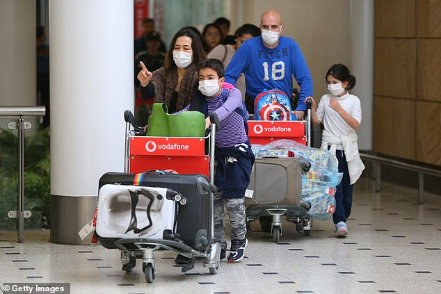Passengers from the final flight out of Wuhan, the Chinese epicentre of the coronavirus outbreak, are pictured landing in Sydney on Thursday. Four people in Australia have been struck down by the virus