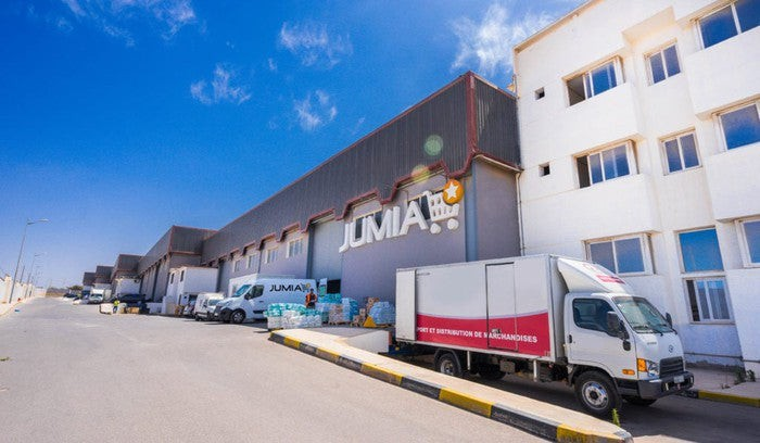 A Jumia warehouse with a truck in front