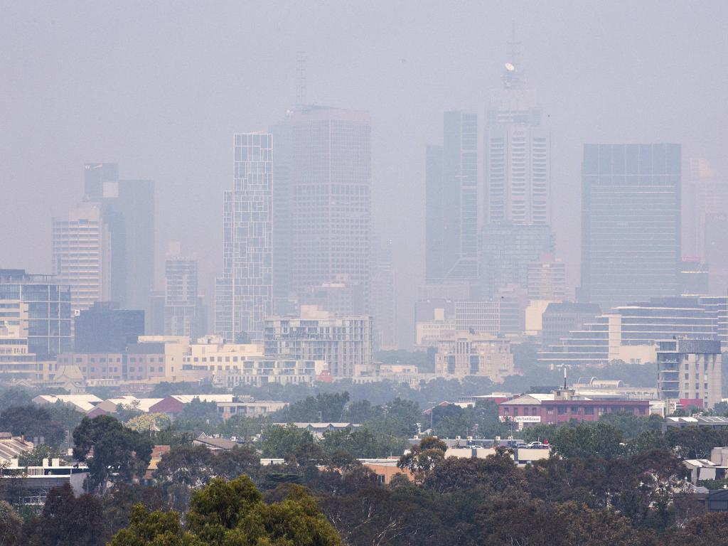 Smoke from bushfires in East Gippsland make the Melbourne Skyline barely visible from Yarra Boulevard, Kew. Picture: Sarah Matray