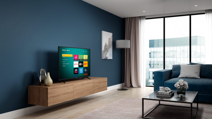 A Roku-powered TV in the living room of an apartment