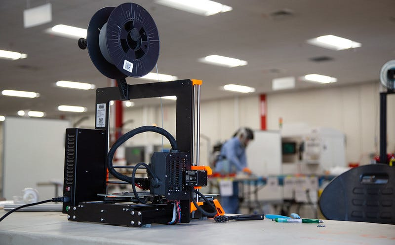3-D printer being used by engineers from University of Lousville Speed School  for producing face shield for local health care professionals in response to the shortage caused by the COVID-19 pandemic.