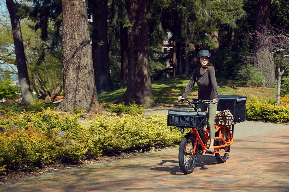 The zero-emission cargo-bike can help small businesses deliver goods and meals at home.