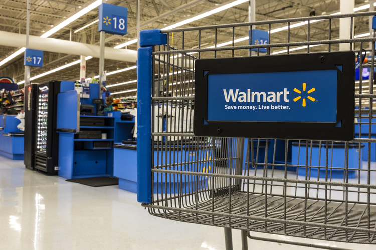 Walmart shopping cart inside store.