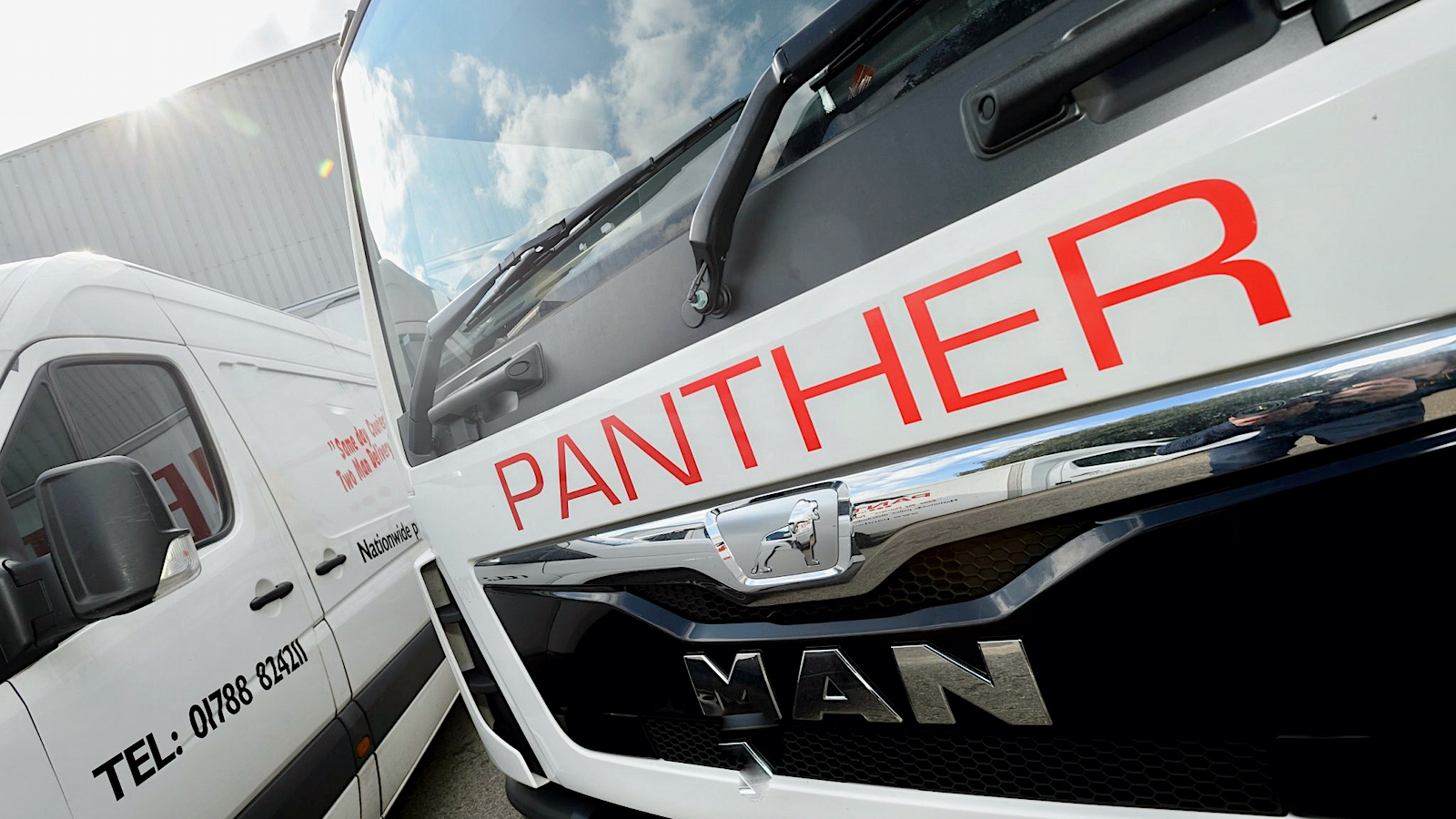 Delivery vehicles of Panther Logistics seen from the front. AIT Worldwide acquired Panther