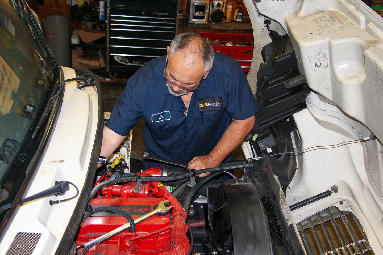 Mechanic servicing an engine